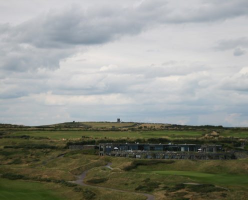 view of Old Head of Kinsale Golf Course from the lighthouse with the signal tower in the distance